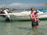 Mom and I by a boat in the water. The water was really shallow for at least a hundred yards.